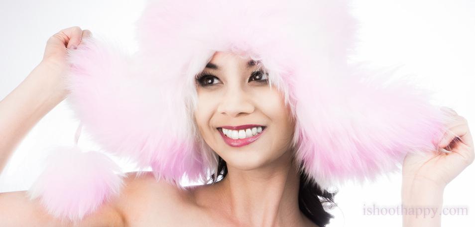 actress model headshot portrait with big fur hat