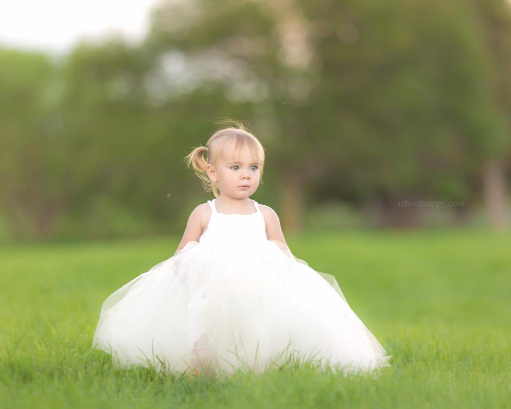 Beautiful toddler baby girl wearing white tutu dress